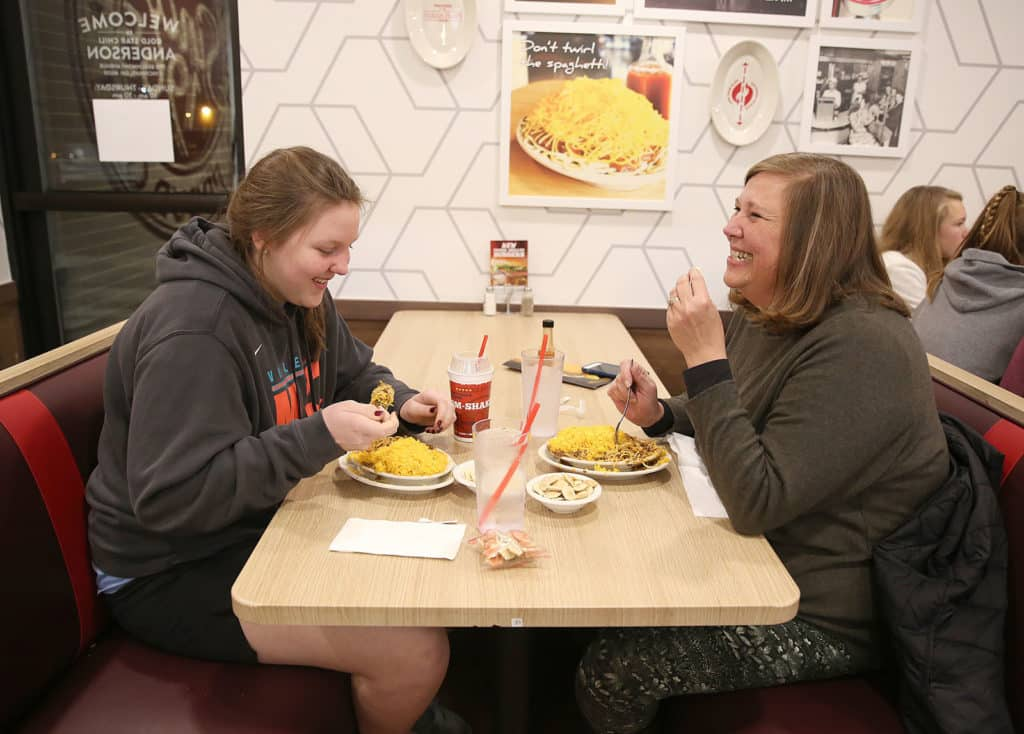 family enjoys their meal at Gold Star Chili franchise
